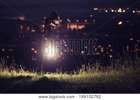Close-up of loving couple dancing against background of night sky with stars, in background night city - bokeh blurred. Concept first love, kiss, Valentine's Day