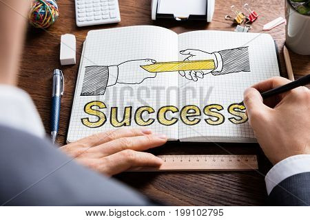 Man Drawing Relay Baton And Success Concept