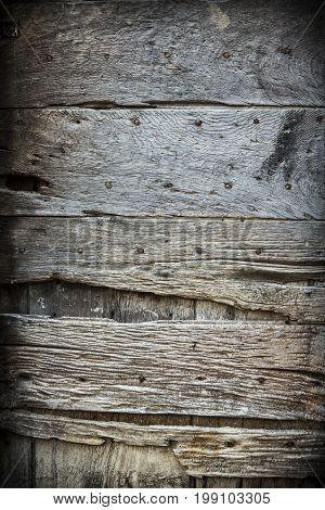 Photo of an old worn wooden door in Italy.