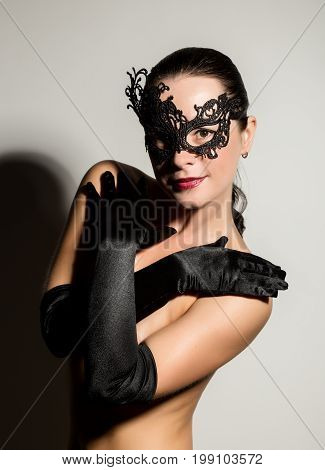 Nudel elegant girl with black gloves and lace mask. Vintage style.