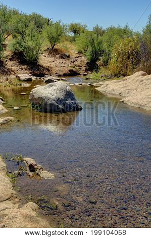A stream flowing through a desert in High Dynamic Range.