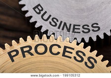 Closeup of business process concept on interlocked cogwheels