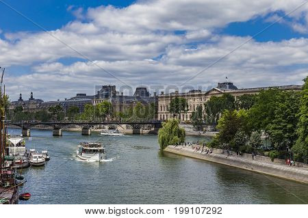 Tourist Boat On River Seine In Paris, France