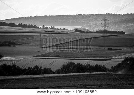 View of the small town of Neustadt (Marburg-Biedenkopf district in Hessen) a suburb and surrounding agricultural land. Black and white.