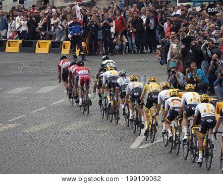 PARIJS , FRANKRIJK - JULY 23 ,2017: Sky cyclists ride the champs elysee in paris after 3 weeks tour de france