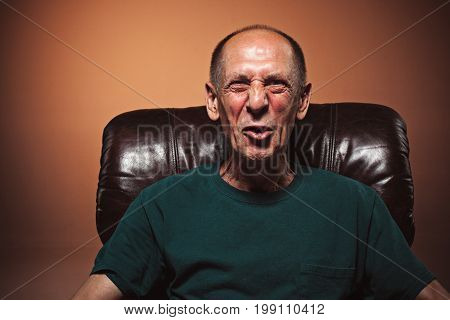 The screaming mature or senior man at studio