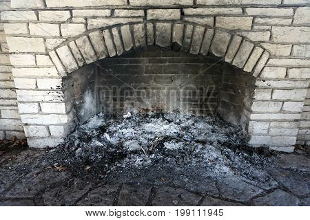 Ashes collect in the fireplace of the historic Shorewood Grove Shelter, in the Hammel Woods Forest Preserve in Shorewood, Illinois.