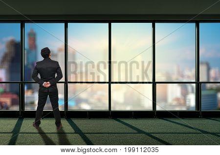 Back side of Businessman looking megalopolis through window Business concept, 3D illustration