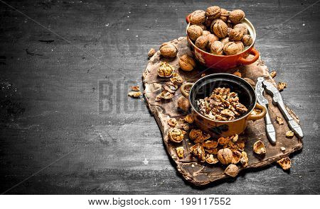 Shelled Walnuts In Bowl With Nutcracker.