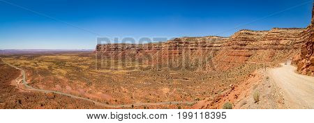 The Moki Dugway located on Utah Route 261 just north of Mexican Hat Utah is a staggering graded dirt switchback road carved into the face of the cliff edge of Cedar Mesa. It consists of 3 miles of steep unpaved but well graded switchbacks (11% grade) whic
