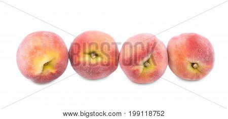 Summer bright red peaches, fruits for healthy diet, nutritious peaches full of vitamins isolated on a white background. Natural fruits. A group of four whole peaches.