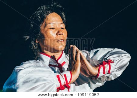 Tai Chi Training In Forest, Color Image, One Woman Only, Nature In Background