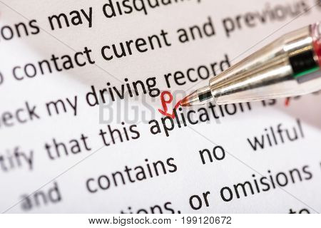 Correcting Application Word With Red Pen On Manuscript