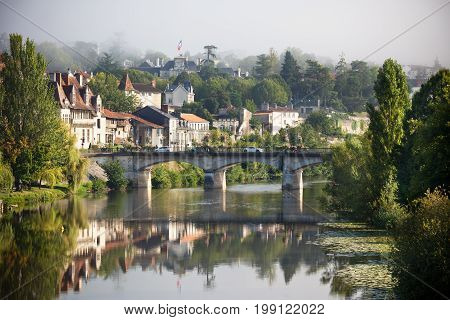 Picturesque view of Perigord town in France. Landscape with the river Vezere.