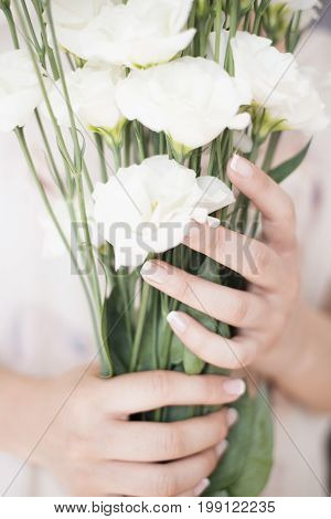 A Young Girl Hand Holding A Large Bouquet Of Fresh White Flowers. Bright Feminine Lifestyle