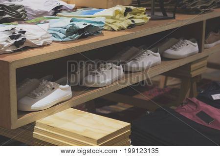 Sneakers Row On The Shelf In A Trendy Clothing Store.