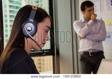 Callcenter is answering the phone customer question.
