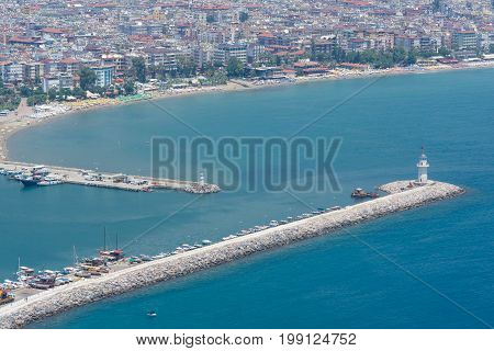 Alanya, Turkey - July 09, 2015: Mediterranean Sea. Sea Port Of Alanya And The Lighthouse. View From