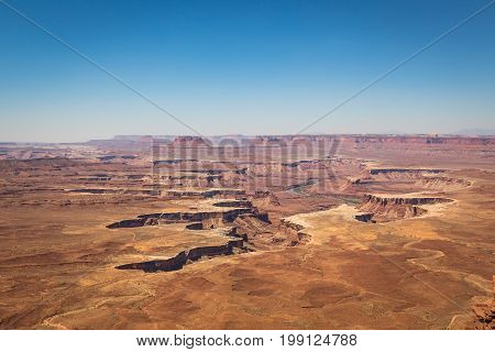 Canyonlands National Park is located in southeastern Utah near Moab. It preserves a colorful landscape eroded into countless canyons mesas and buttes by the Colorado River the Green River and their respective tributaries.