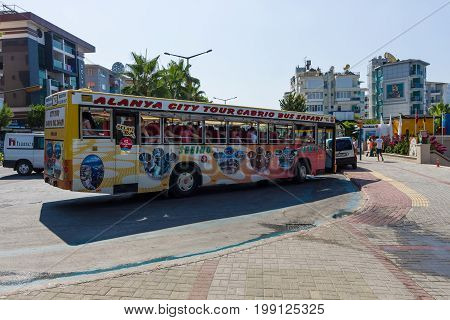 ALANYA TURKEY - JULY 09 2015: City tour to the cabrio bus. Alanya - a popular holiday destination for European tourists.