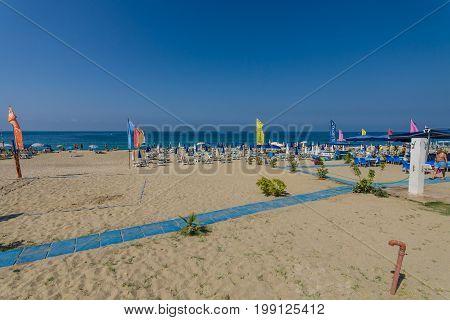 ALANYA TURKEY - JULY 09 2015: The city beach in Alanya. Alanya - a popular holiday destination for European tourists.
