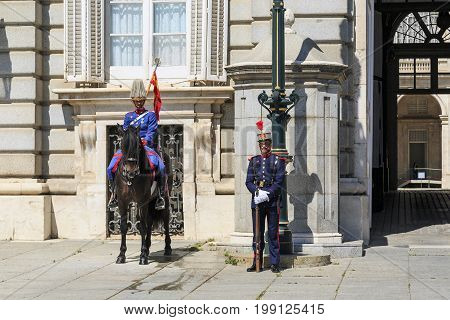 MADRID, SPAIN - MAY 24, 2017: It is guard at the Royal Palace on the side of the Plaza Oriente.
