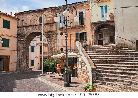 Atessa, Chieti, Abruzzo, Italy: picturesque corner with the ancient city gate Porta di San Nicola (Arco 'Ndriano)and old staircase in the medieval town