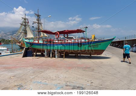 ALANYA TURKEY - JULY 09 2015: Repair of motor boats. Seaport of Alanya. Alanya - a popular holiday destination for European tourists.