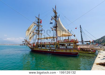 ALANYA TURKEY - JULY 09 2015: The ship in the sea port of Alanya. Alanya - a popular holiday destination for European tourists.