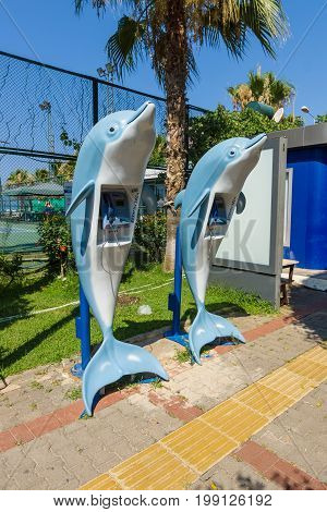 ALANYA TURKEY - JULY 09 2015: Local telephone. Telephones in the form of dolphins. Alanya - a popular holiday destination for European tourists.