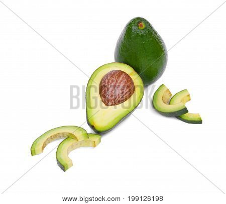 Fresh and organic whole and cut in half avocados with a large stone and a rough leathery skin, isolated on a white background. A few slices of fruit near the healthful avocado. Copy space.