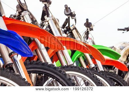 Motocross bike stand in a row. Motocross tires and wheels