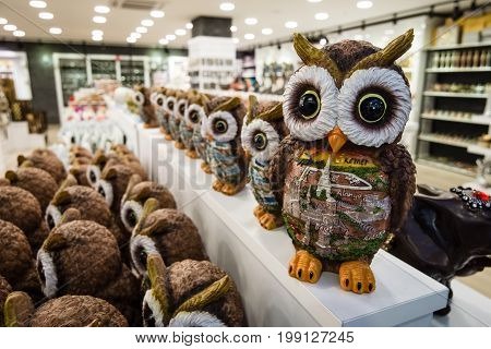 KONAKLI TURKEY - JULY 10 2015: Sales of souvenirs (owl) in one of the shops large and popular among tourists shopping center on the Anatolian coast near the town of Alanya.