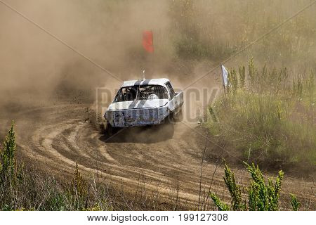 Old Wrecked Cars Stock Race. Racing In The Open Air With Dust