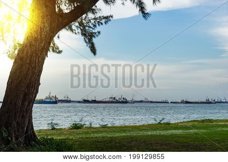 View of the sea from East Coast Park in Singapore under the beautiful blue sky cloudy with Sun flare