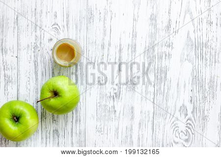 Apple puree for baby on light wooden background top view.