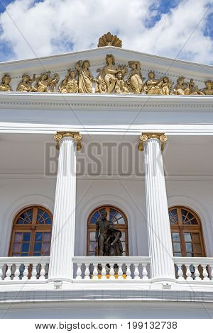 Facade with balconies and columns of the old Teatro Nacional Sucre in downtown Quito, Pichincha, Ecuador.