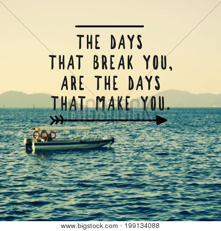 Inspirational and motivational quotes - the days that break you are the days that make you. Retro styled blurry background.