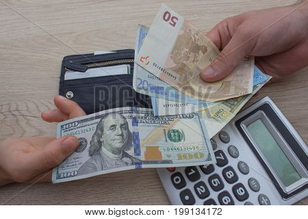 finances currency exchange rate business and people concept - close up of male and female hands giving or exchanging money