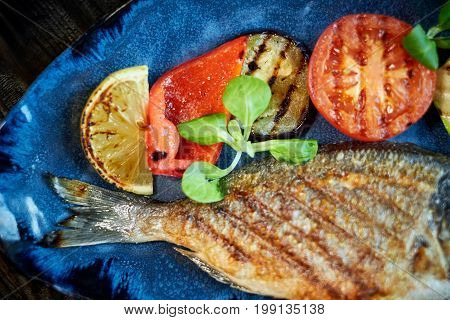 Grilled Fish dish - roasted fish and vegetables