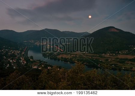 European river Elbe in Dolni Zalezly and Sebuzi villages when viewed from Mlynaruv kamen lookout in czech central mountains tourist area at sommer evening