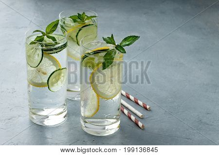 Detox Water With Cucumber, Mint And Lemon On Gray Stone Background.