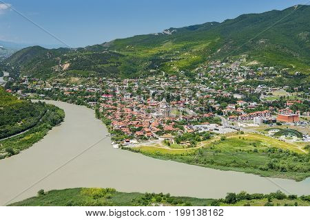 view of the Mtskheta, one of the oldest city of Georgia at the confluence of the rivers Kura ( Mtkvari ) and Aragvi from Jvari Monastery, Mtskheta, Georgia