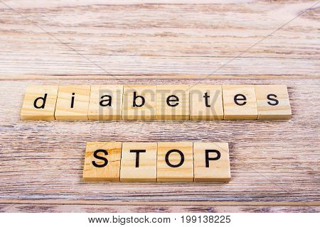 word diabetes on wooden cubes. Stop diabetes. On a wooden table
