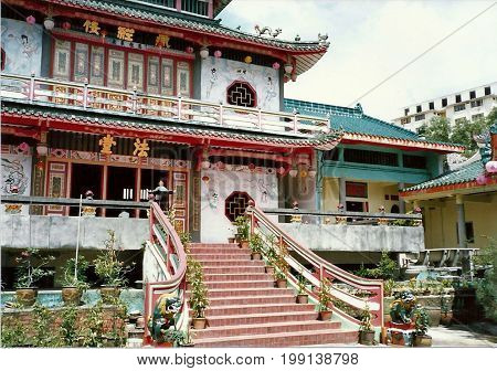 SINGAPORE / CIRCA 1990: An ornate stairway leads to the entrance of the Kong Meng San Phor Kark See Monastery, also called the Bright Hill Pujue Chan Monastery, Singapore's largest Buddhist temple.