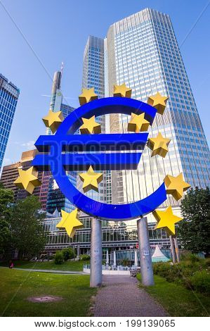 FRANKFURT GERMANY - JUL 11 2013: Euro sign outside the European Central Bank. The ECB is building new premises in Frankfurt due for completion in 2013.