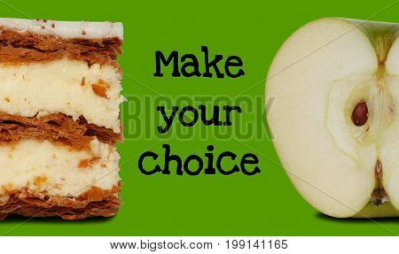 Cake and apple on green background with text Make your choice (healthy eating choice)