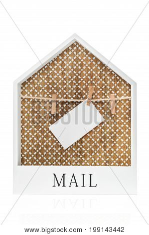 Frame in the form of a house with clothespins holding an empty sheet for mail isolated on a white background