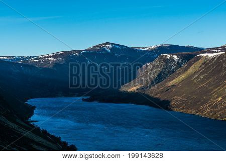 Looking down onto Loch Muick with the Broad Cairn in the background.