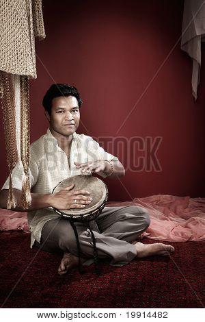 Indian Man Plays A Tabla